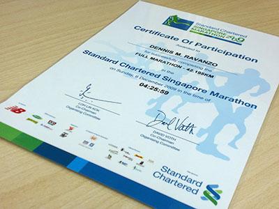 Laminated SCSM full marathon finisher's certificate