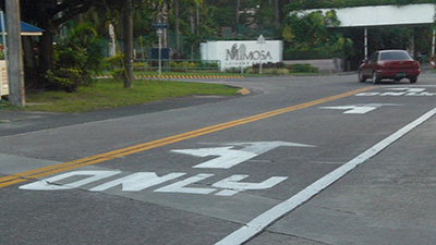 See how this left turn (only) sign painted on the road differs widely from standard Philippine sign?