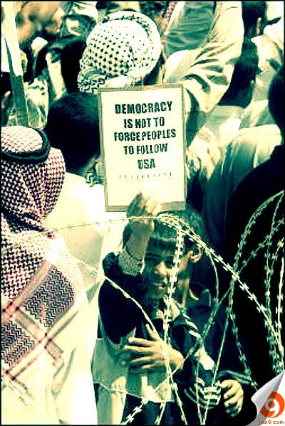 Iraq kid holding a sign