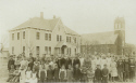 Sepia toned Assumption School with crowds of people