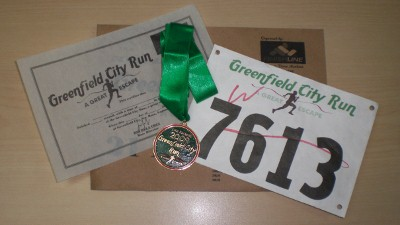My race certificate, bib, and finisher's medal